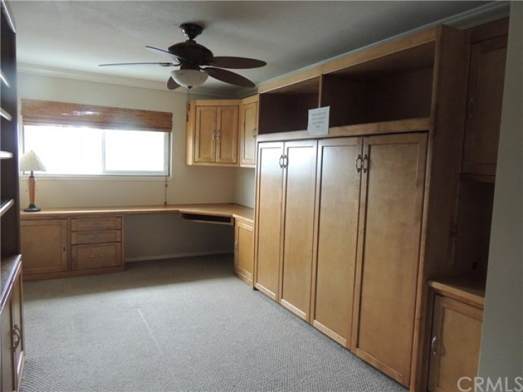 Large master bedroom currently has a queen Murphy bed and built-in desk and shelves.  The newer owner can utilize this great space or remove for an extra large master bedroom