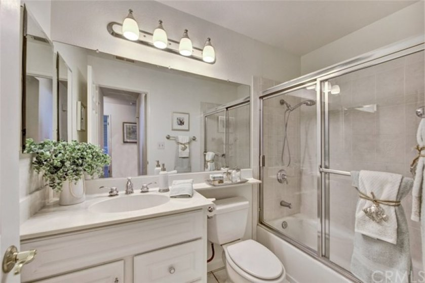 Main bath serves the other two bedrooms.  It has also been remodeled and has tub and shower