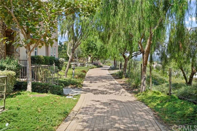 Well-kept common areas w/gorgeous walking paths & large greenbelts