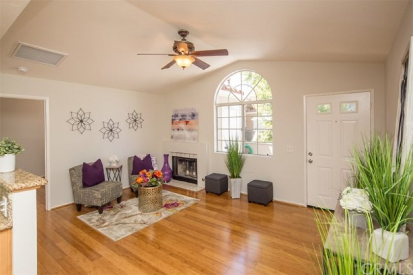 spacious living room with high ceilings, gas fireplace, bamboo flooring