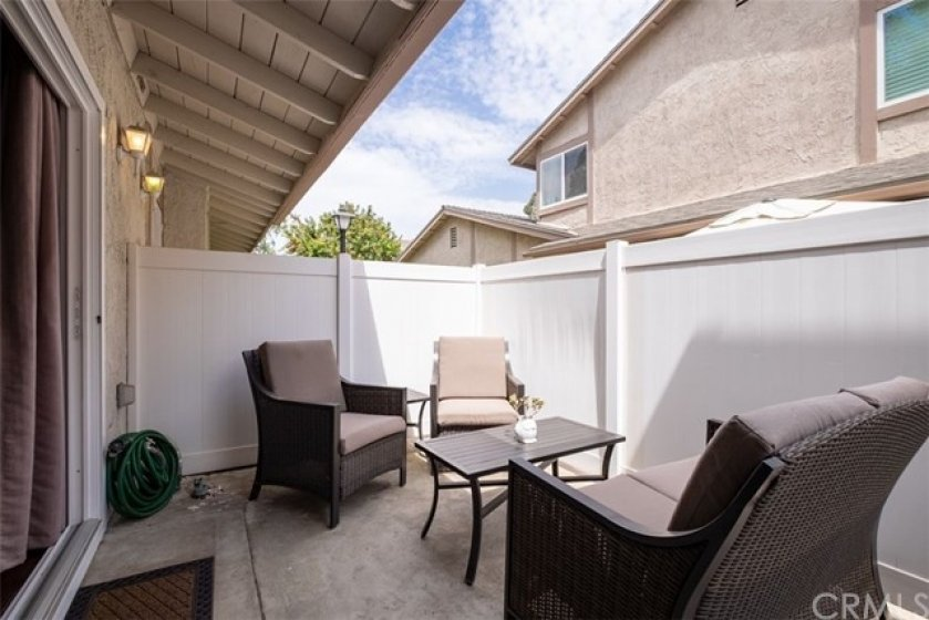 Outside Patio Area, very private with Vinyl Fencing!