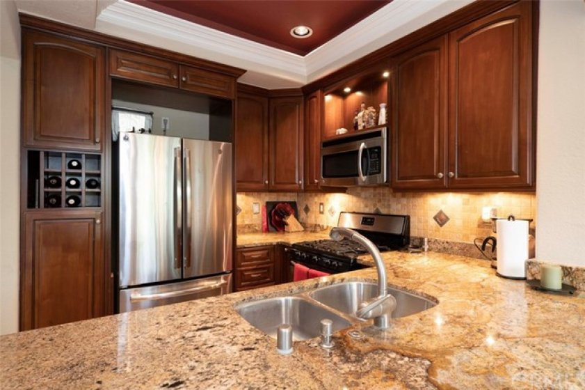 Gourmet Granite Kitchen - note tray ceiling and display cabinets