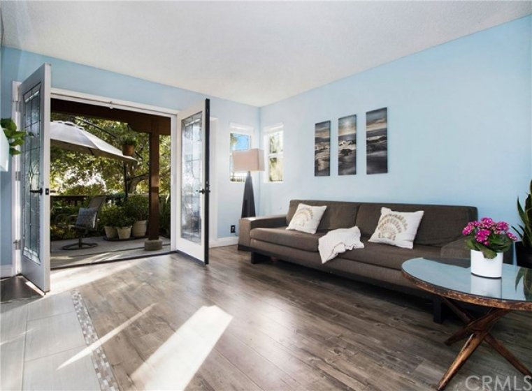 Living room with double French doors opens to patio