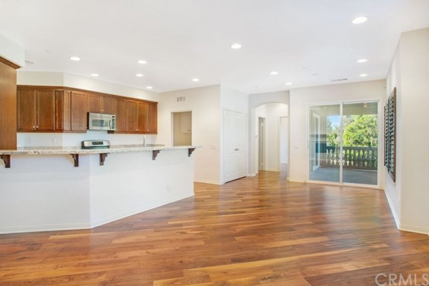 Open concept floor plan with large kitchen peninsula, perfect for bar stools.