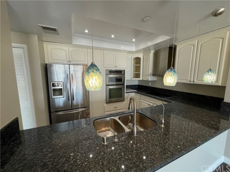 stainless steel appliances in upgraded kitchen