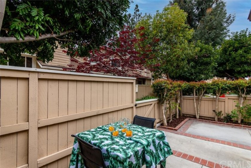 Lovely patio with brick ribbons.  Lots of space to entertain.