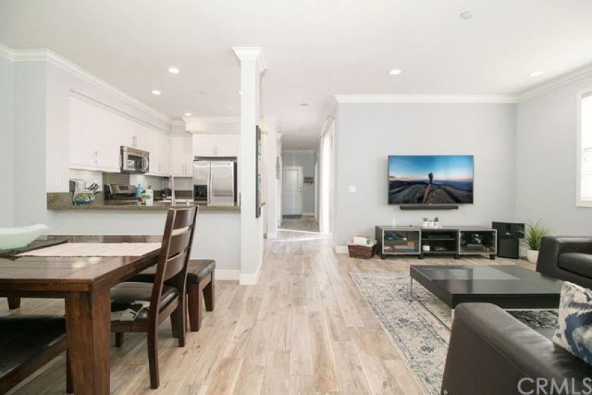 Great open living space, open to the living, dining and kitchen and graced with upgraded wood style tile flooring.