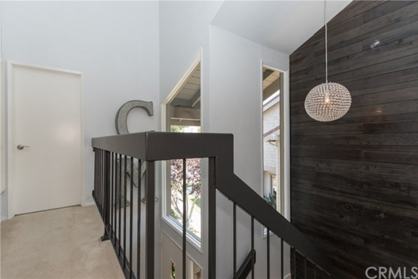 Gorgeous wood wall on the stair landing!