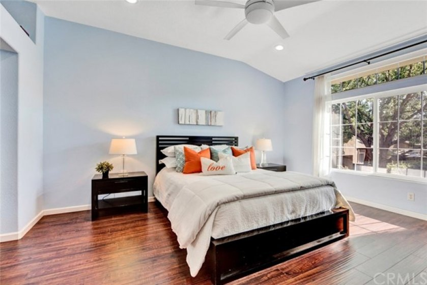 At the end of the hall is the master suite with cathedral ceiling, cooling ceiling fan and plenty of room for big furniture.