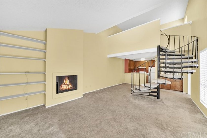 Wonderful Open Floorplan Livingroom with Staircase to Second Story Loft.