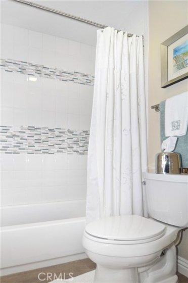 Custom tile in tub/shower secondary bath.