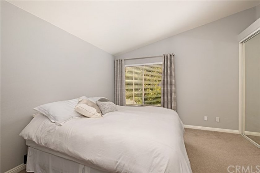 Very spacious owner's bedroom with vaulted ceilings and large closet