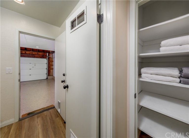 End of the Hallway Cabinet, looking into the Laundry Room and into the Garage