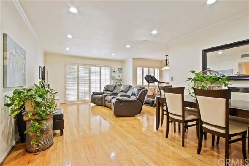 Open floor plan flooded with sunlight welcomes you upon entry