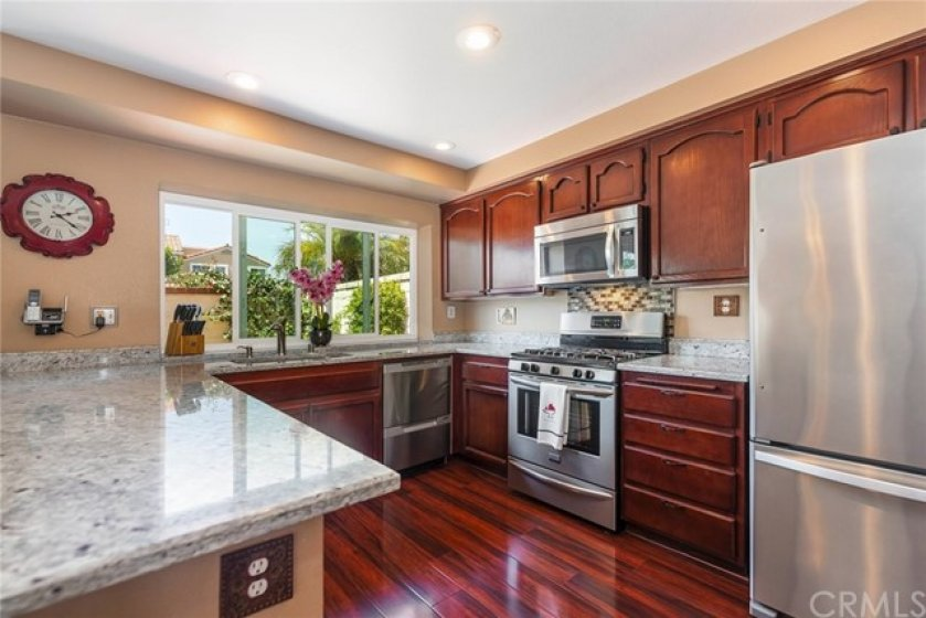 Kitchen features newer stainless steel appliances including a Fisher Paykel 2-drawer dishwasher, stainless steel kitchen sink and fixtures.