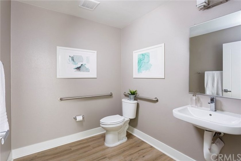 Main level powder room next to office.