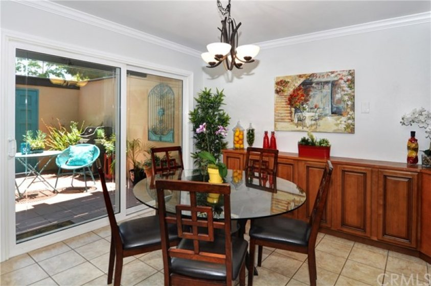 Spacious Dining Room with Custom Buffet Counter & Dual Pane Slider to Private Patio