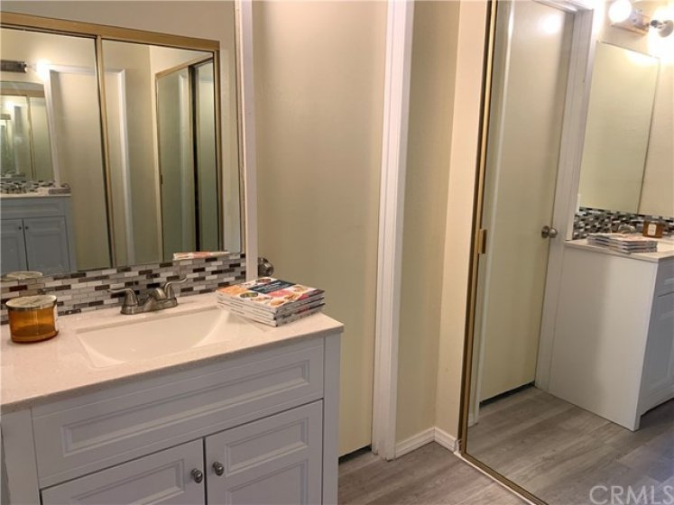 Master on-Suite bathroom with extra large two mirrored closets