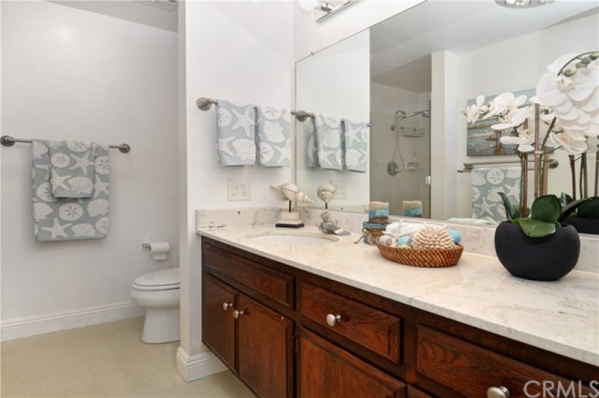Master Bathroom with Extra Long Vanity and Tiled Walk-In Shower with Clear Glass Door