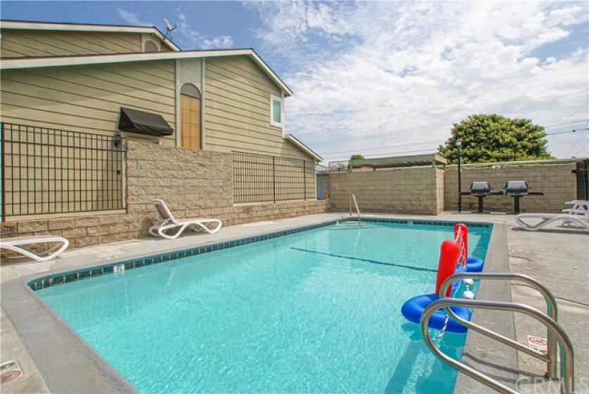 Sparkling community pool and barbecue area