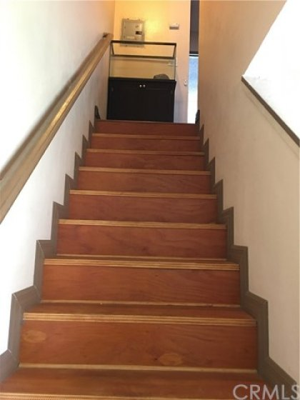 Stairway leading to upstairs bath and bedrooms.