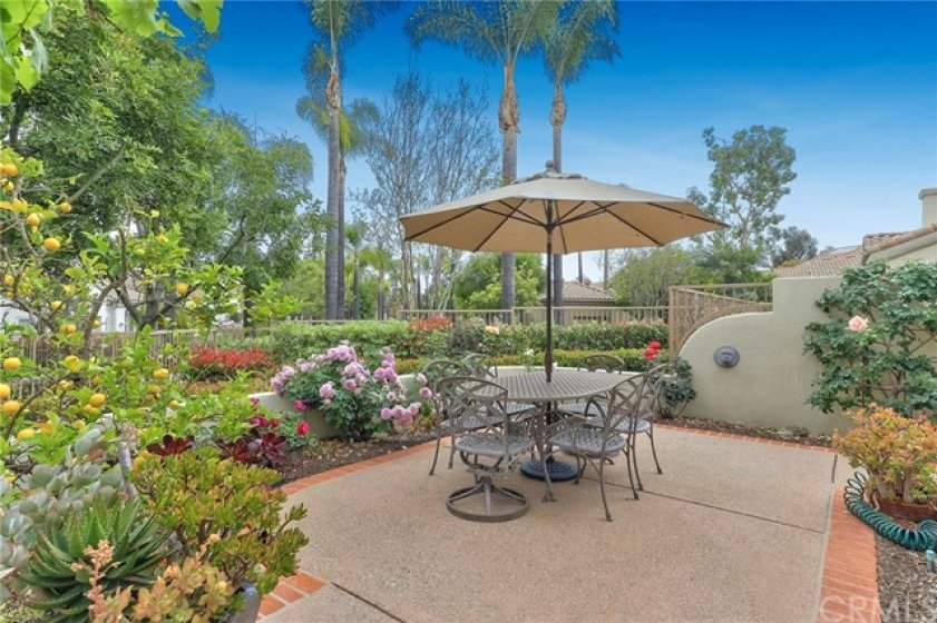 Beautifully Landscaped Back Patio area with a view of the greenbelt