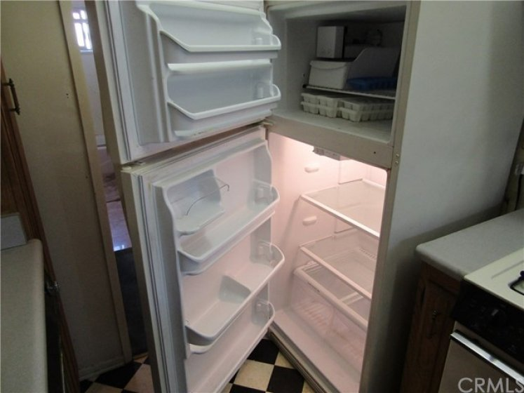 Seller is leaving the refrigerator for you!