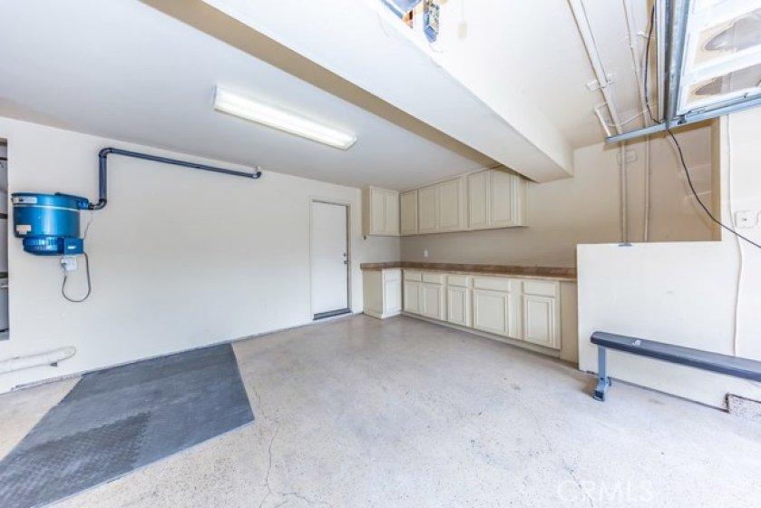 2-car garage w/Built-in cabinets