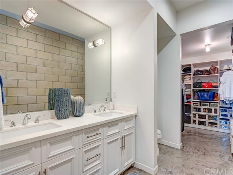 Master bathroom with dual sinks, quartz counter tops, and large walk in closet.