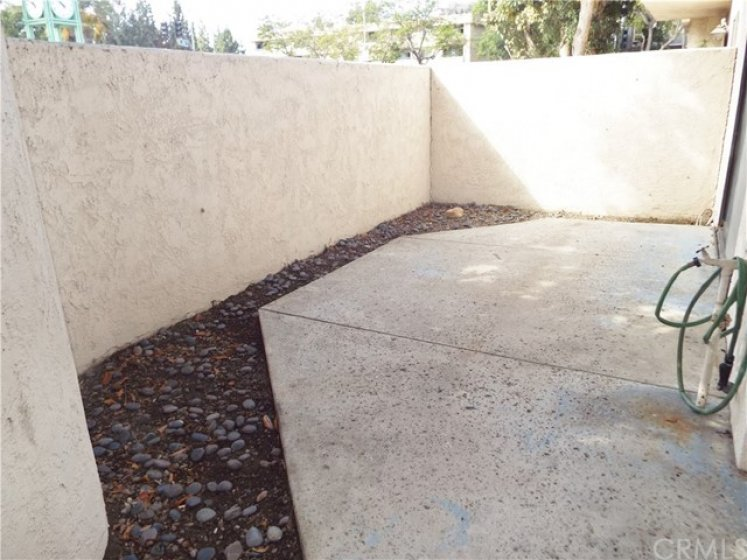 Walled off private rear patio.