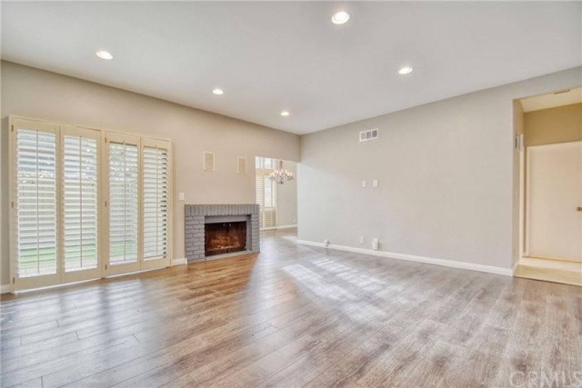 Fireplace in living room. Sling door to left of fireplace leads to back patio.