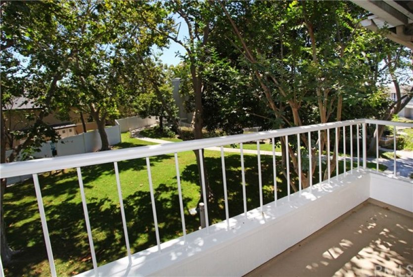 Beautiful view from master bedroom balcony. Enjoy your morning coffee in this peaceful setting!