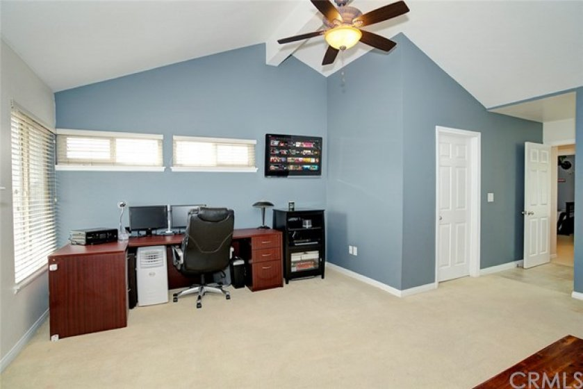 Master suite with sitting room or home office. View of walk in closet
