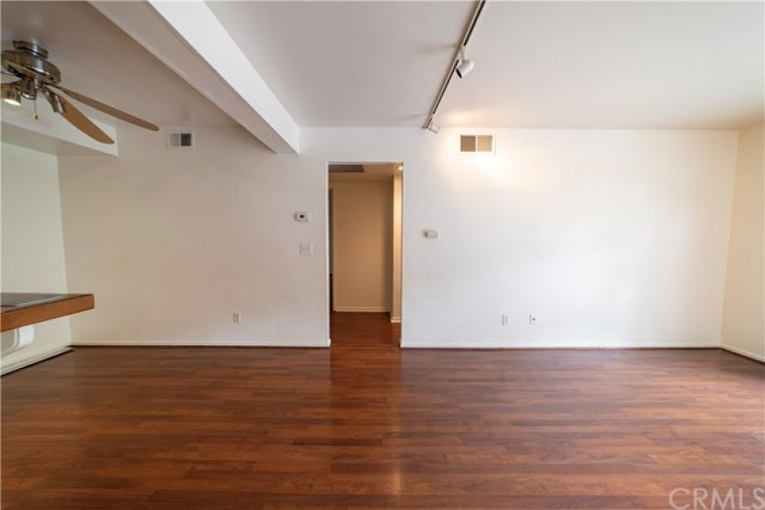 Spacious living room with beautiful hardwood floor!