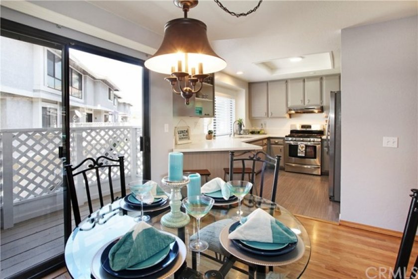 Dining area is open to kitchen for convenient stove to dinner plate
