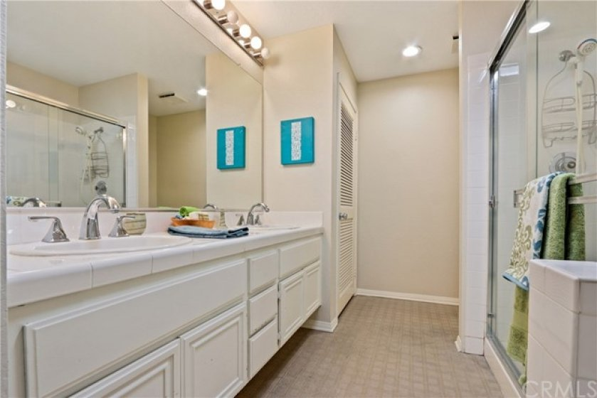 BIG bathroom has double sink, stall shower and soaking tub! Also stackable washer/dryer.