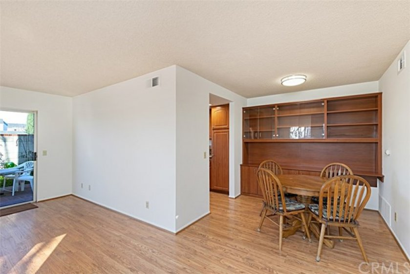 As you enter Your New Home you are greeted with hardwood floors, and notice the built-in cabinet on the far wall in the Dining Room area, with the Kitchen entry just to the left