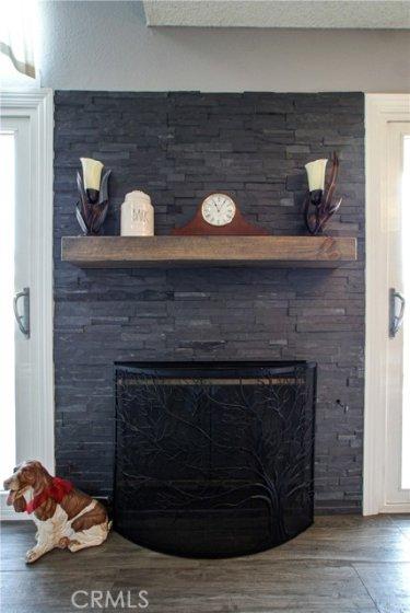 Lovely stackstone woodburning fireplace
