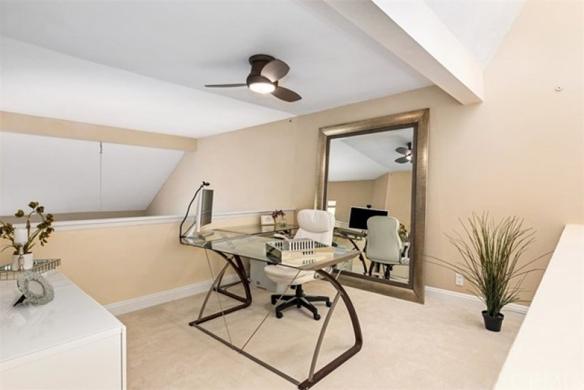 The spacious open loft is currently being used as an office.  Easily converted into a third bedroom.