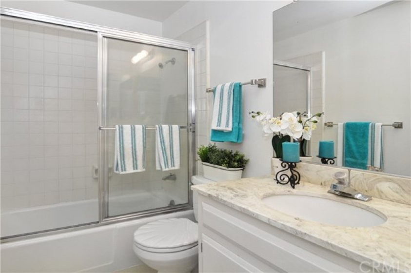 Guest Bathroom With Tiled Tub/Shower Combination