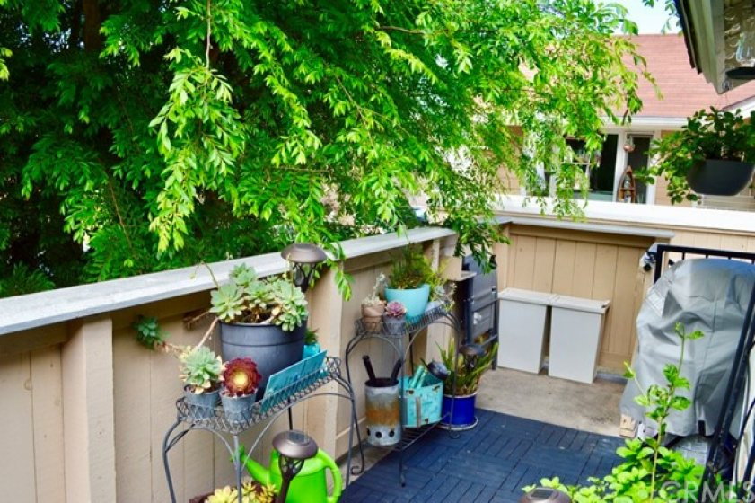 Patio/deck is gated with a lock. Space for a BBQ, outdoor recycling bins and gardening area.