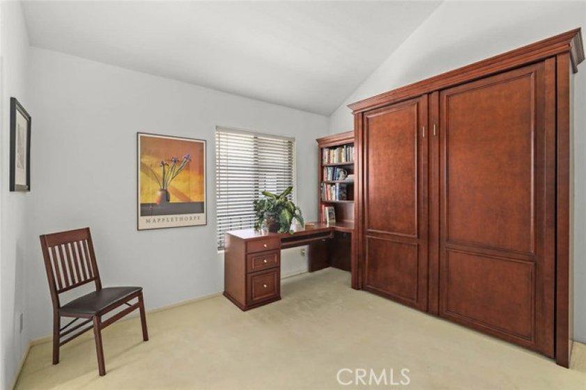 Custom Cherry wood built-in desk and Murphy bed in 2nd bedroom.