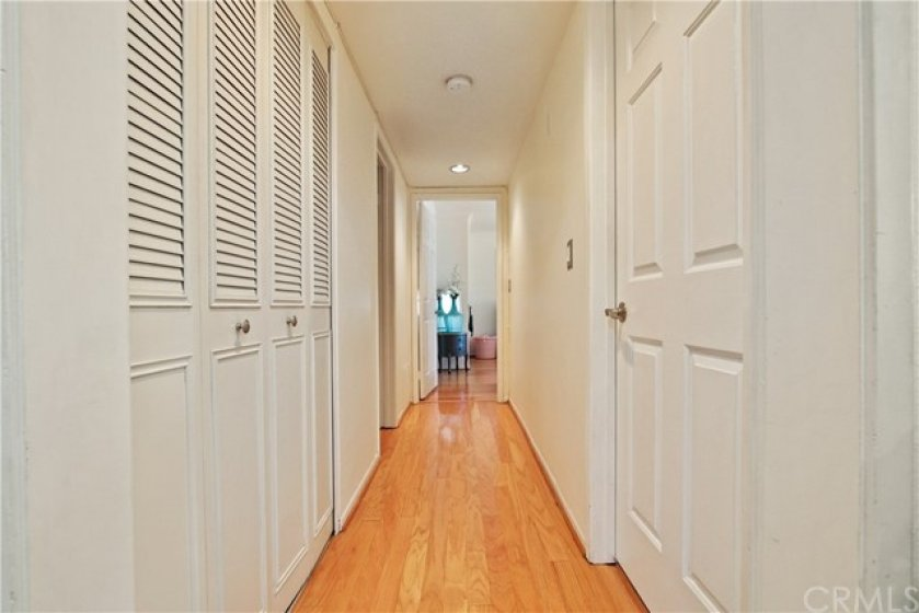 Closet on the left is the perfect area to install washer and ventless dryer approved by the HOA!  Center hall leads to bedrooms and baths