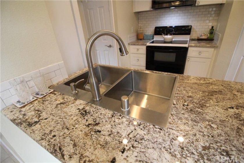 New Granite countertops and designer stainless steel sink