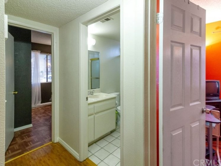 TWO downstairs bedrooms share a full bath.