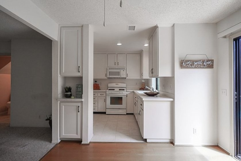 Abundance of storage, corian counter tops newer cabinets w/ huge walk in pantry w/ washer / dryer hook ups.