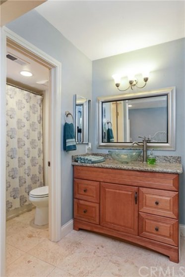Both master bedrooms featurre update bathrooms with new vanity, counter tops, tile flooring and recess lighting...