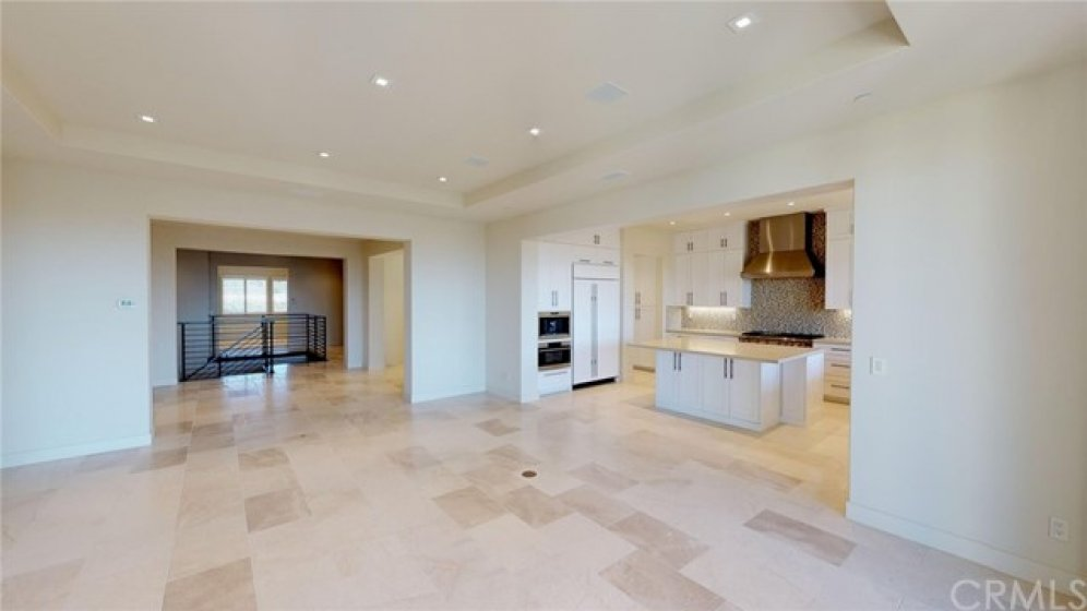 Kitchen built-in appliances include fridge, coffee maker, steam oven and warming drawer to name a few.