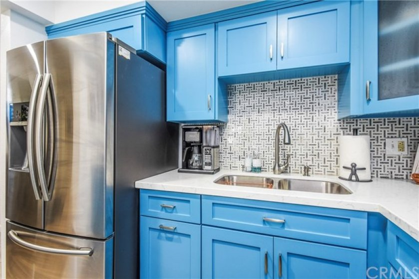 French Door Stainless Steel Samsung Refrigerator and stainless steel sink.