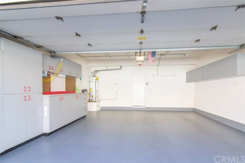 WOW! Custom Storage spaces on both sides of Direct Access Two-Car Garage, Work Bench, and Built In Air Compressor. Painted concrete flooring for a super clean finish.
